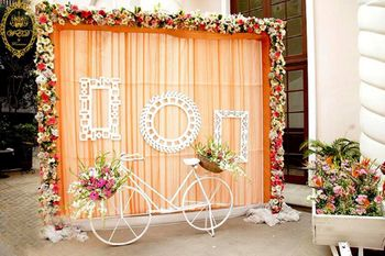 Photo of Light orange photobooth with white cycle