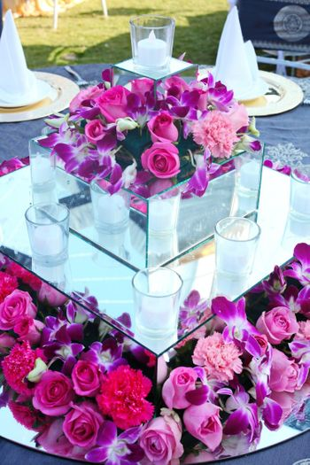 Photo of Purple table setting with candles and flowers