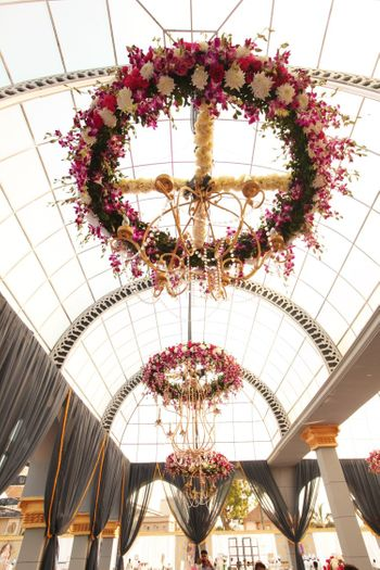 Photo of Suspended floral chandelier with pink and white flowers