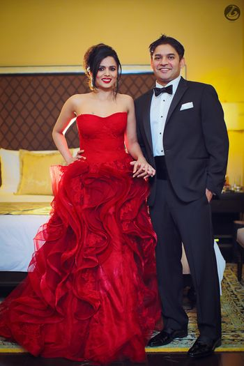 Red strapless ruffled gown for cocktail party