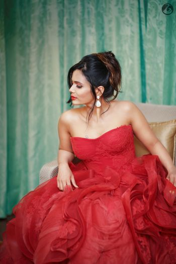 Bride in red strapless ruffled gown
