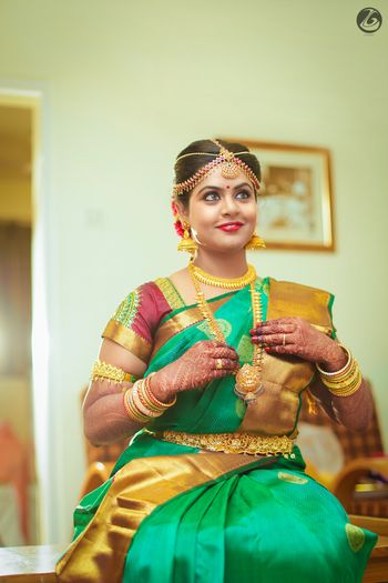 Photo of South indian bridal look in aqua and gold saree