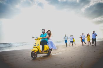 Beach pre wedding shoot couple on scooter and friends