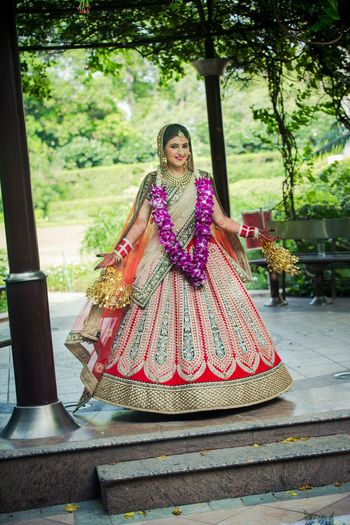 Flared red bridal lehenga with green patch work