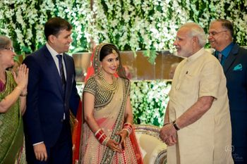 Photo of Narendra modi greeting couple at wedding