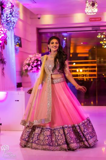 Photo of Light pink and blue net lehenga for engagement