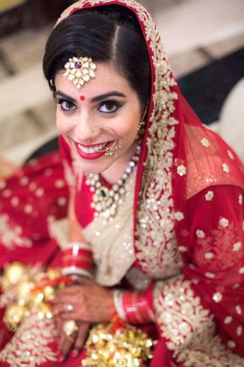 Red and dull gold bridal look