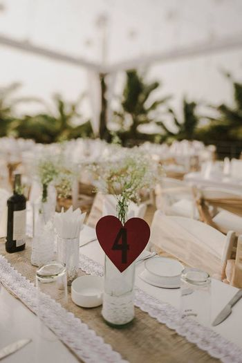 Photo of White table setting with heart numbers