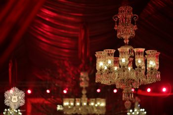 Royal glass chandelier with candles in decor