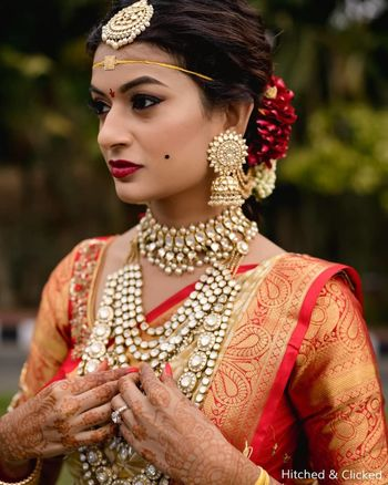 Photo of unique south indian bridal jewellery with polki and pretty earrings