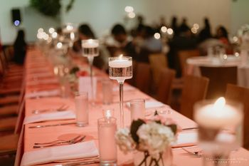 Photo of elegant table setting with candles and peach theme