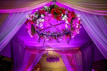 Floral chandelier with red and pink flowers