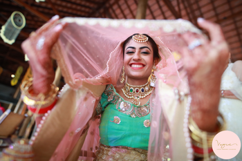 Photo of Fun bridal portrait with bride in pink and aqua lehenga