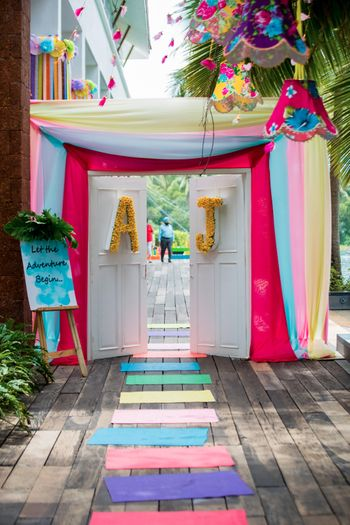 Photo of Colourful entrance decor with door and monograms