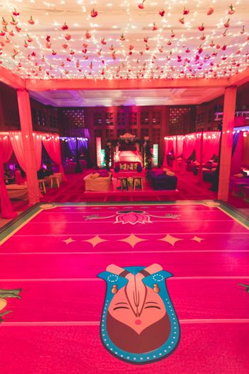 Photo of Bright pink dance floor with flowers and lights above