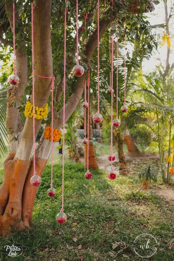 hanging orbs with florals for tree decor