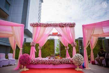 Light pink mandap with dreamy florals