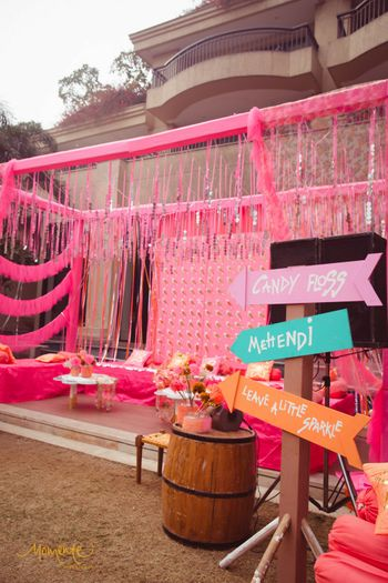 Photo of Light pink decor with direction board and gota strings