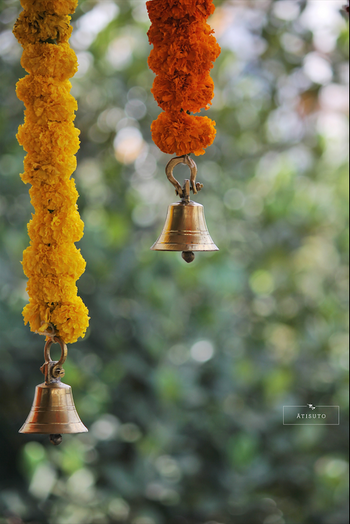Photo of Genda phool strings with metal temple bells