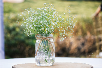 Photo of Baby's breath in mason jar as centerpiece