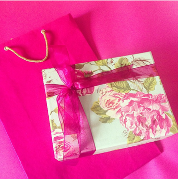 floral print card box with hot pink rubbon in satin