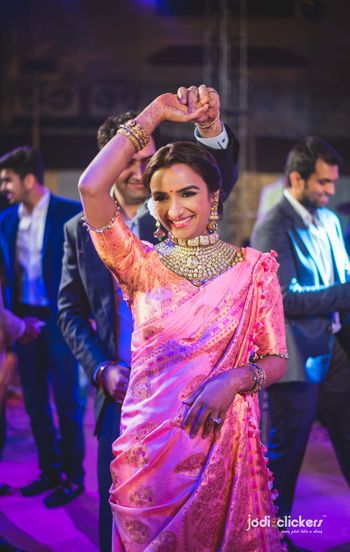 Bride in light pink saree with vintage choker necklace