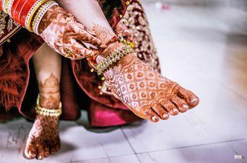 Photo of Bridal pajeb with mehendi feet