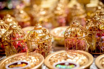 Favours packed inside gold birdcages