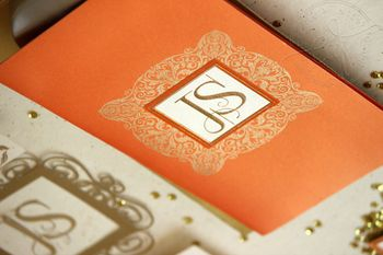 Photo of Orange rust wedding card with initials