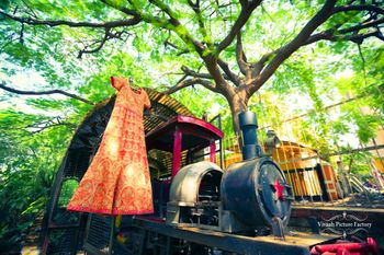 Bridal outfit on hanger on toy train engine