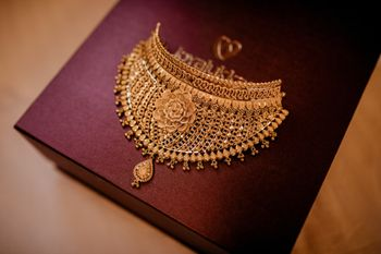 south indian bridal jewellery with gold necklace rose motif