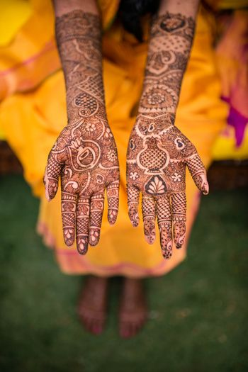 Mehendi design with musical instruments