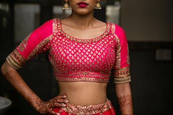 Photo of Pink bridal lehenga blouse with sequin and zari work