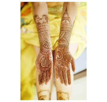 Half and half mehendi design with eiffel tower design