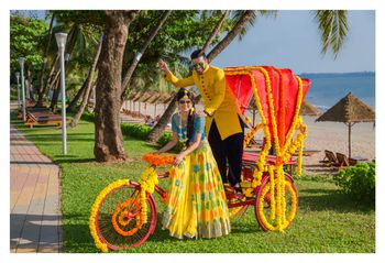Decorated yellow and orange rickshaw at mehendi