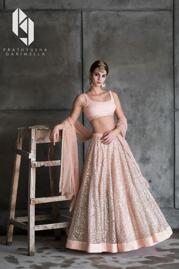 Shimmery peach engagement lehenga