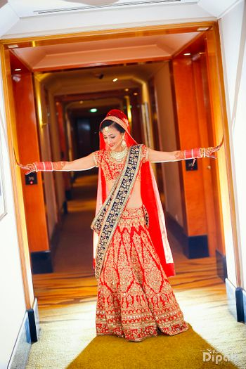 Photo of red and blue bridal lehenga