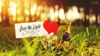 Save the date with champagne and a heart
