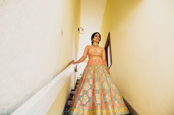 Peach blue and gold light lehenga for mehendi