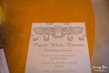 White wedding itinerary with elephant motifs