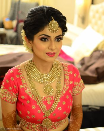 Gold finish jewellery bridal look with pink lehenga