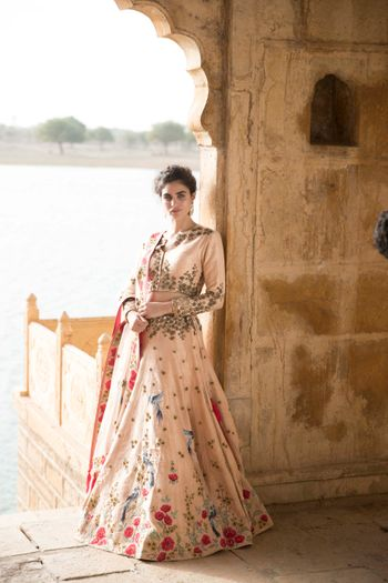 Photo of Blush pink lehenga with floral motifs and zardozi work