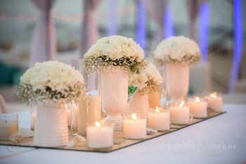 Pretty all white table setting with candles
