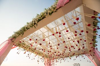 Light pink and white mandap with hanging floral strings