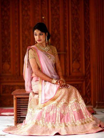 Photo of light pink and gold pastel sangeet or wedding lehenga for morning wedding