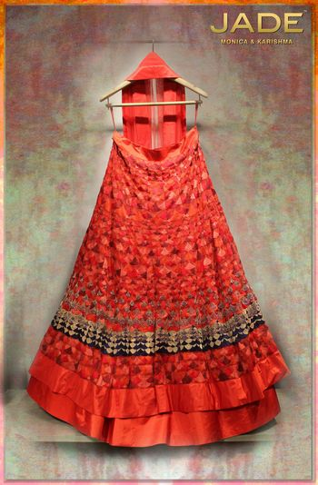 Photo of red bridal lehenga all over thread work
