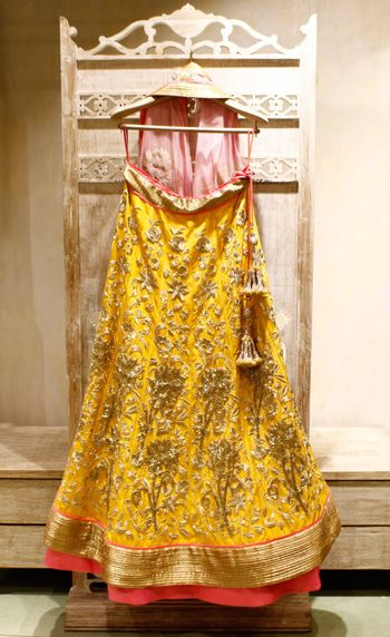 Photo of Yellow matka silk bridal lehenga with all over gold intricate embroidery