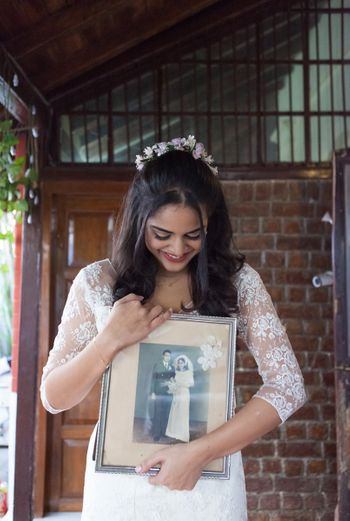 Photo of Click a photo holding the wedding photo of your mother and father