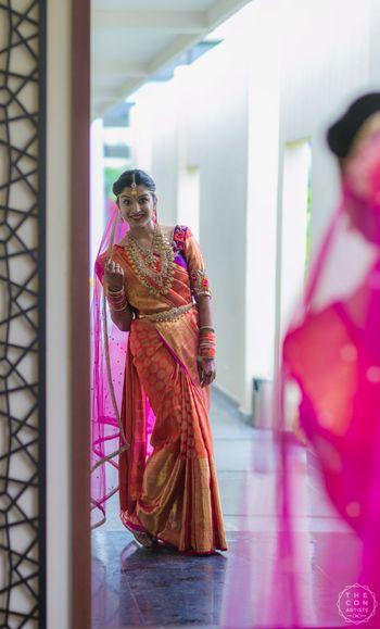 South indian bride in red and gold kanjivaram saree
