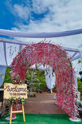 Pink entrance decor with rustic feel welcome board
